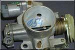 Нажимая на педаль дроссельной заслонки(газа), он изменяет нропускную способностъ впускного коллектора для.